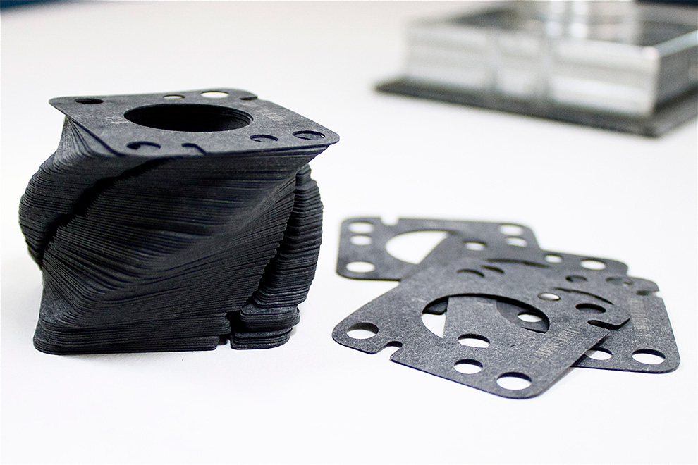 Gaskets for hermetic refrigeration compressors
